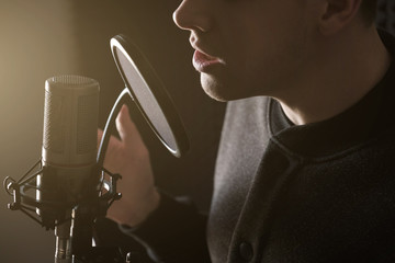 A close photo of the lips of the singing guy at the microphone. Horizontal frame