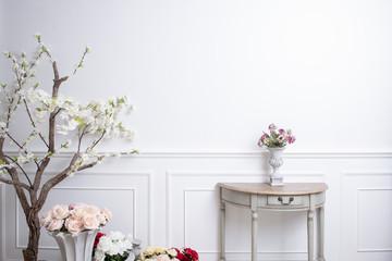 Elegant interior decoration with flowers on  white wedding background