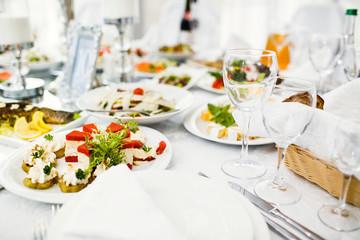 delicious dishes on the table in the restaurant. serving table.