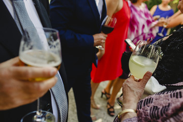 Having a drink at a wedding