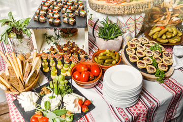 table with different type of snacks preparing for party.