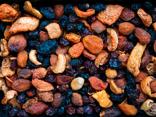 mix of dry fruits and nuts, prunes, dried apricots, apples, raisins, background