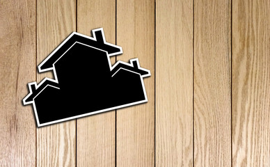 Houses Shape Card board on Wood Texture. Photo Image