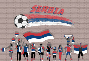 Serbian football fans cheering with Serbia flag colors in front of soccer ball graffiti