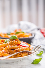Italian food and pasta pene with bolognese sause on plate