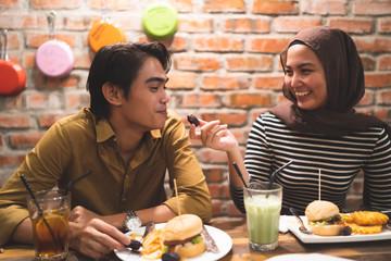 malay couple breaking fast during ramadhan