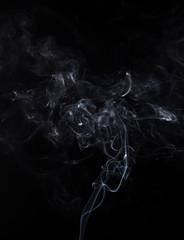 White smoke of smoldering aromastick