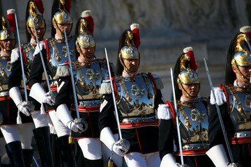 Members of the Italian elite military unit Cuirassiers' Regiment stand guard at the Vittoriano monument during the Republic Day military parade in Rome