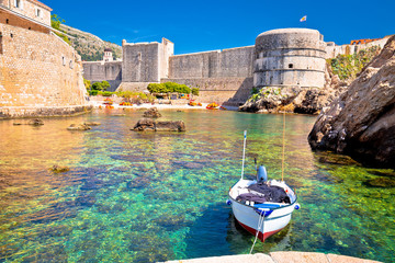 Small harbor under Dubrovnik city walls view