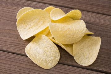 chips with wooden background