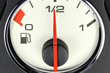 fuel gauge in car dashboard - half full
