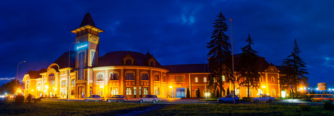 Uzhgorod, Ukraine - SEP 28, 2008: Panorama of beautiful railway station building at night