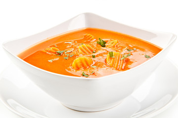 Carrot soup on white background
