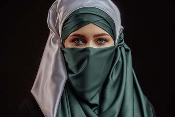 inner beauty. pleasant shy pilgrim in satin green and white hijab