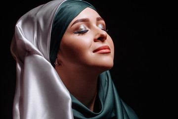 close up portrait of Muslim girl looking up and getting inspiration. enjoy the life. positive thinking.