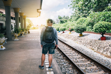 Traveler with backpack of railway station