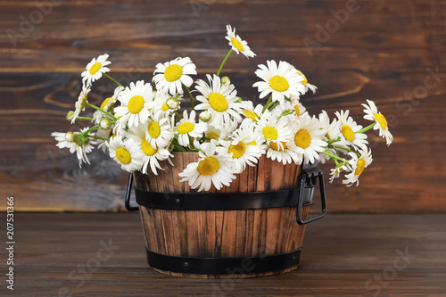 Mothers Day card with daisy flowers in a wooden bucket
