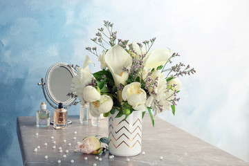 Vase with bouquet of beautiful flowers on table
