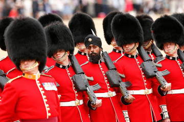 The Household Division, led by the Coldstream Guards rehearse Trooping the Colour for the Colonel's Review ahead of the Queen's birthday parade next week, on Horseguards Parade in central London