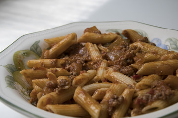 Delicious dish prepared from macaroni with tomato and meat