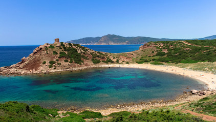 The ancient tower of Porticciolo rises above the beautiful beach