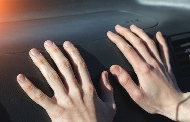 Hands on the airbag in the car salon