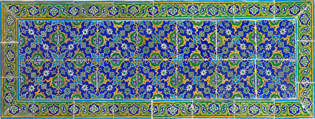 Ancient colorful tiles with oriental pattern close up background