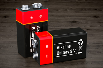 9V batteries on the wooden background, 3D rendering