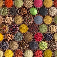 Fototapete - Colorful spices and herbs background. large set of seasonings in cups, top view