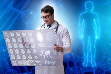 Telemedicine concept with doctor looking at x-ray image