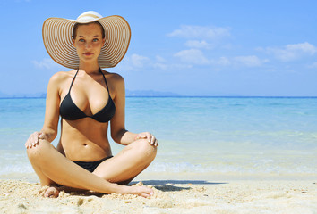 Sensual lady relaxing on a tropical beach