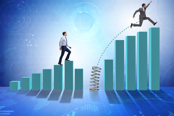 Business people jumping over bar charts