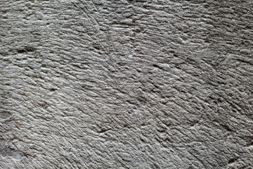 Rough grey stone texture photo. Ancient polished stone background. Weathered rock relief.