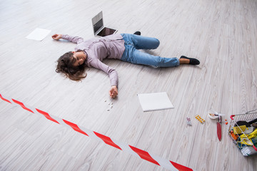 Dead woman on the floor after commiting suicide