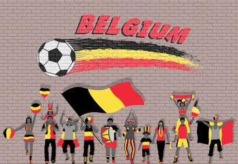 Belgian football fans cheering with Belgium flag colors in front of soccer ball graffiti