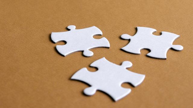 Puzzle three piecesonthebrownbackground.