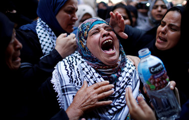 Relative mourns during the funeral of Palestinian nurse Razan Al-Najar, in Khan Younis in the southern Gaza Strip