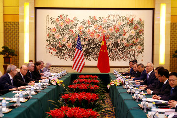 U.S. Commerce Secretary Wilbur Ross and Chinese Vice Premier Liu He attend a meeting at the Diaoyutai State Guesthouse in Beijing