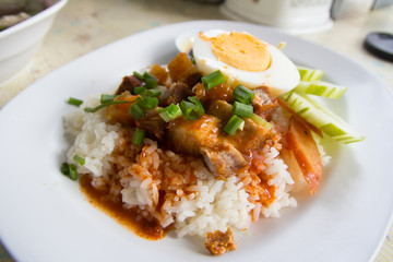 Barbecue pork and roasted pork with stream rice.Thai food