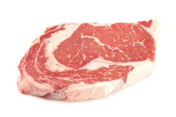 Raw Rib Eye Steak on a White Background