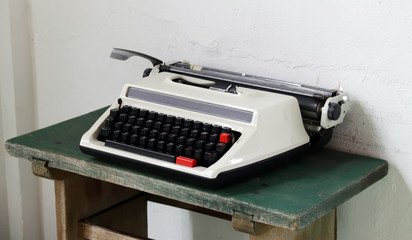 The old typewriter on the old desk.