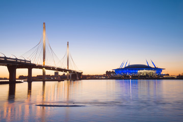 Cable-stayed bridge over the Petrovsky fairway in the night scenery, Saint-Petersburg