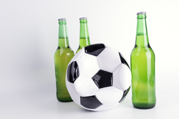 One deflated soccer ball and bottles of beer