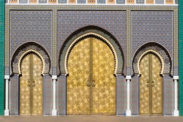Brass gate and zellige mosaic tilework on Dar al-Makhzen or Dar el-Makhzen royal palace in Fez, Morocco