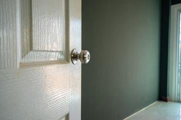 retro white wood door open to empty room