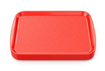 Red plastic food trays stack