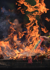 Flames of burning incense in an altar of a Buddhist temple, Hangzhou, China.