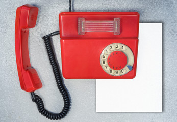red antique rotary phone with blank sheet of paper with copy space for your text, top view