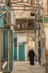 Acre, Israel - May 10, 2018 : Muslim woman walking in old Acre