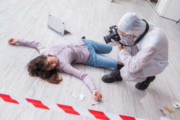 Forensic investigator at the crime scene investigating woman mur